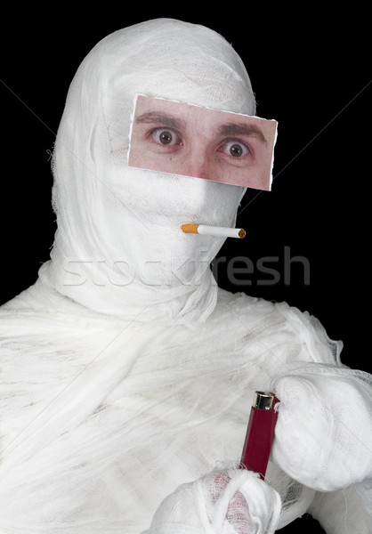 Mummy with false eye and lighter  Stock photo © pzaxe