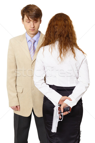 Young man and the woman armed with a pistol Stock photo © pzaxe