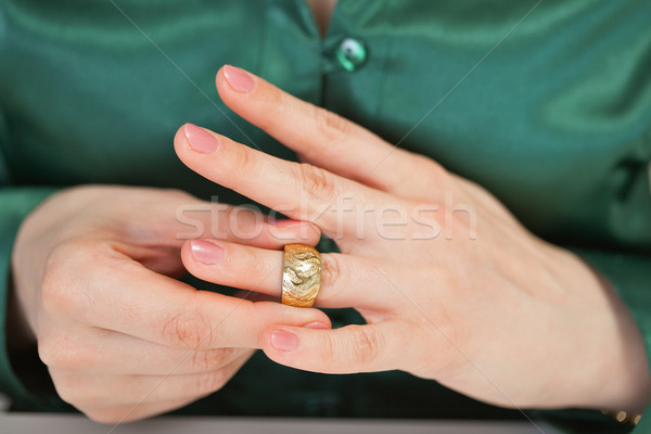 Woman tries on large gold ring Stock photo © pzaxe