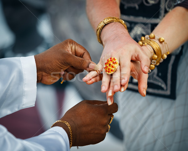 Wedding in Sri Lanka. Ritual - priest ties little fingers with a Stock photo © pzaxe