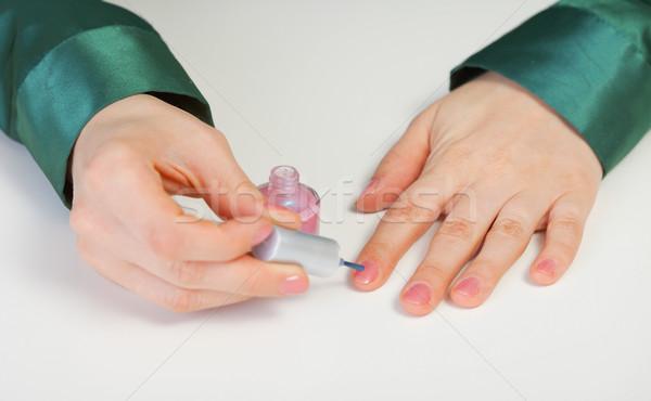 Woman paints to itself nails Stock photo © pzaxe