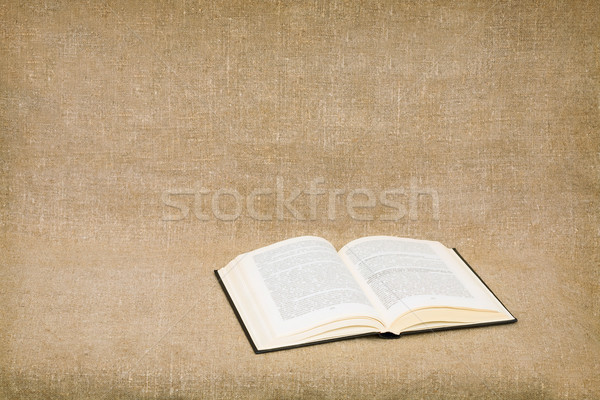 Opened book on canvas background Stock photo © pzaxe