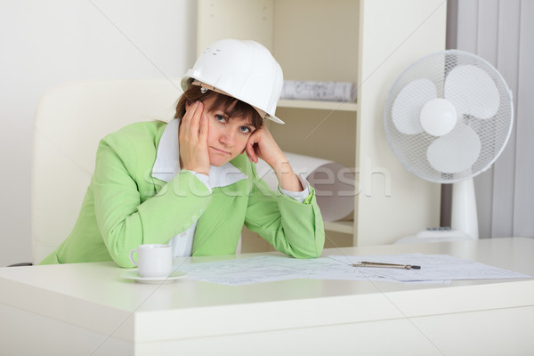 Thoughtful woman - builder in helmet Stock photo © pzaxe