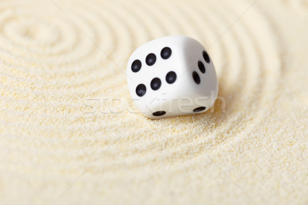 Abstract composition in sand with white dice - Zen Garden Stock photo © pzaxe