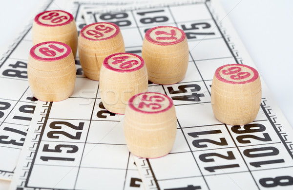 Stock photo: Kegs bingo, against playing cards