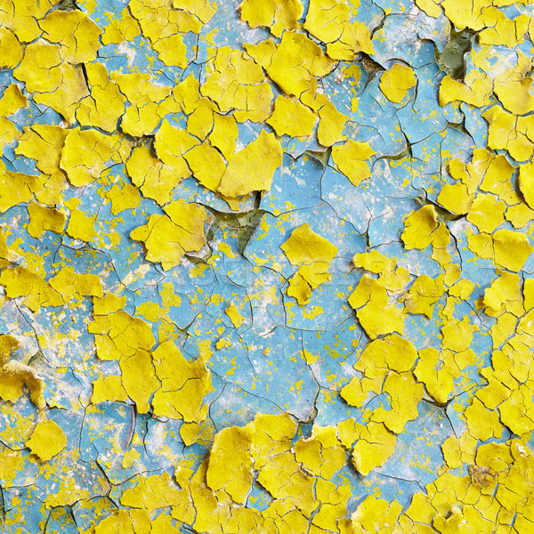 Yellow wall covered with scraps of paint Stock photo © pzaxe