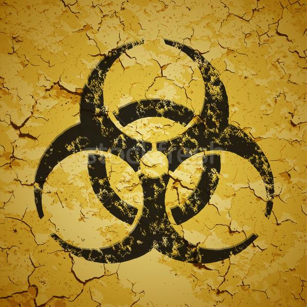 Black emblem painted on grunge wall - biohazard logo Stock photo © pzaxe
