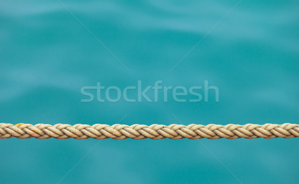 Thick ship rope on the sea water background Stock photo © pzaxe