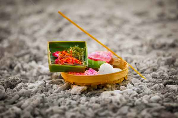 Offerings to gods in Bali with flowers, rice and aroma stick Stock photo © pzaxe