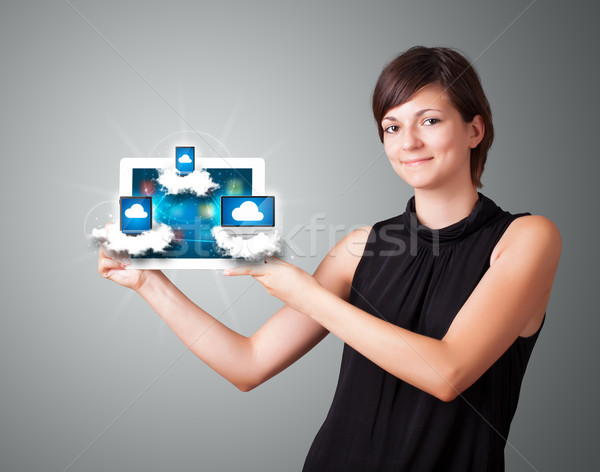 Stok fotoğraf: Genç · kadın · tablet · modern · bulutlar