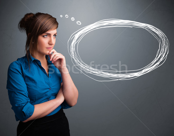 Beautiful young lady thinking about speech or thought bubble Stock photo © ra2studio