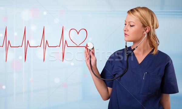 Giovani infermiera ascolto abstract impulso rosso Foto d'archivio © ra2studio