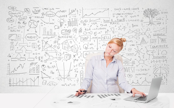 Pretty young businesswoman planning and calculating various business ideas Stock photo © ra2studio