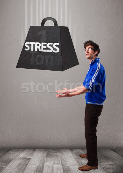 Stock photo: Handsome boy holding one ton of stress weight