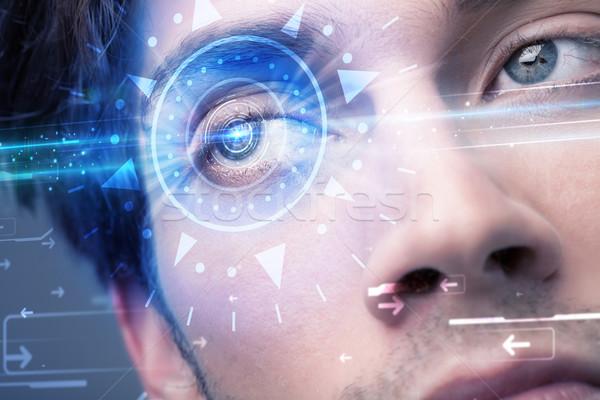 Cyber man with technolgy eye looking into blue iris Stock photo © ra2studio