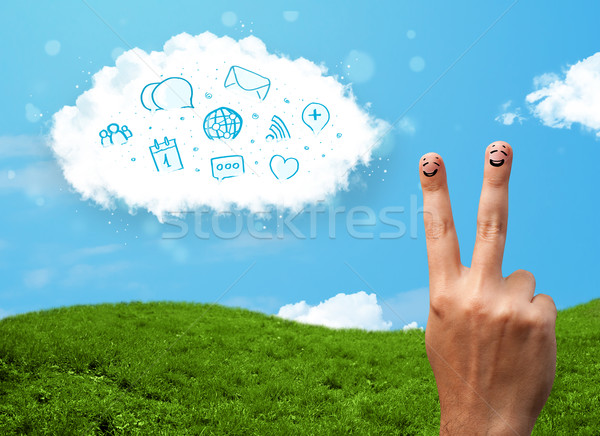 Stock photo: Happy cheerful smiley fingers looking at cloud with blue social icons and smybols