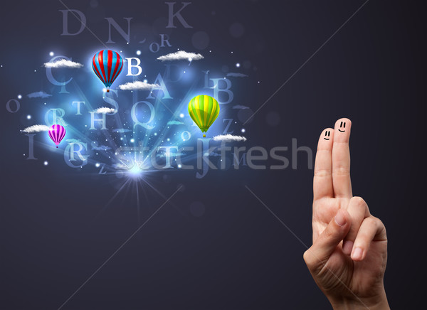 Happy cheerful smiley fingers looking at hot air balloons in the cloudy sky Stock photo © ra2studio