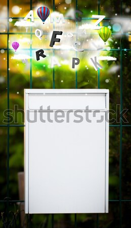 Mail box with letters comming out Stock photo © ra2studio