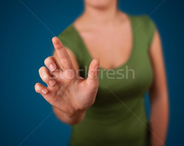 Donna immaginario pulsante mano Foto d'archivio © ra2studio