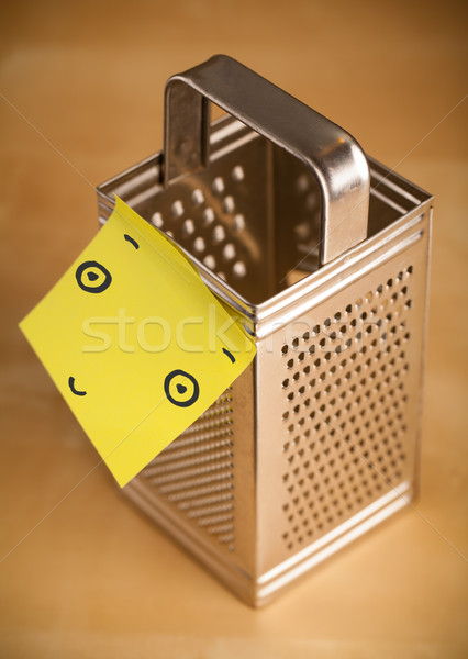 Post-it note with smiley face sticked on a grater Stock photo © ra2studio