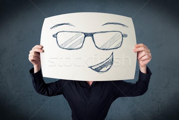 üzletember tart papír mosolygós arc fiatal fej Stock fotó © ra2studio