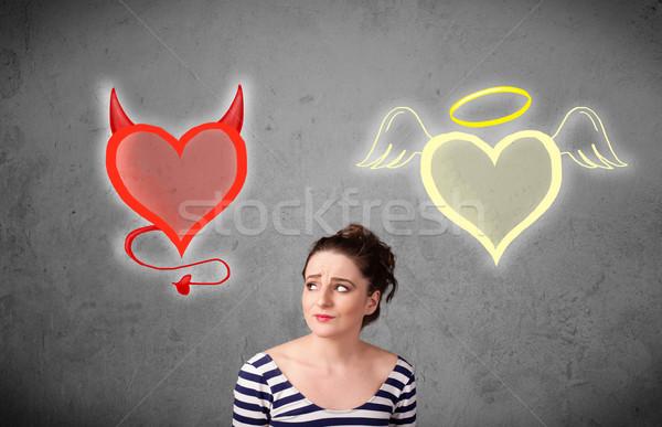 Mulher em pé anjo diabo corações bastante Foto stock © ra2studio