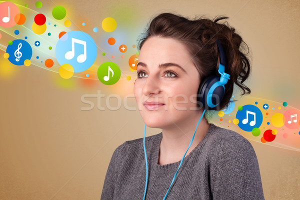 Young woman listening to music with headphones  Stock photo © ra2studio