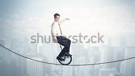 Enerjik iş adamı atlama köprü boşluk gökyüzü Stok fotoğraf © ra2studio