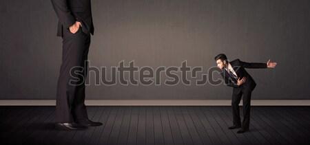 Kicsi óriás főnök lábak férfi háttér Stock fotó © ra2studio