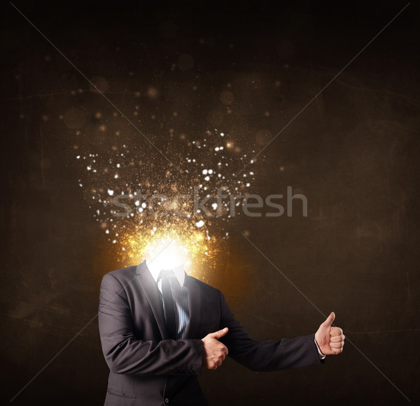 Business man with glowing exploding head Stock photo © ra2studio