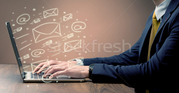 Sending client news letters on laptop Stock photo © ra2studio