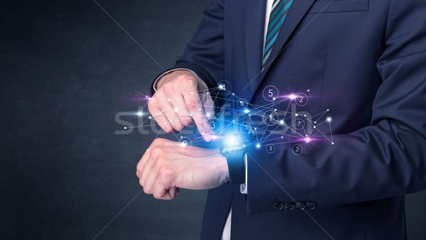 Hálózatok férfi visel kéz technológia üzletember Stock fotó © ra2studio