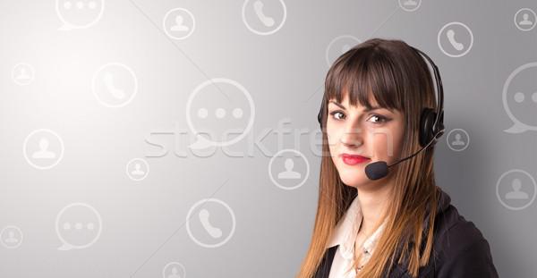 Young female telemarketer Stock photo © ra2studio
