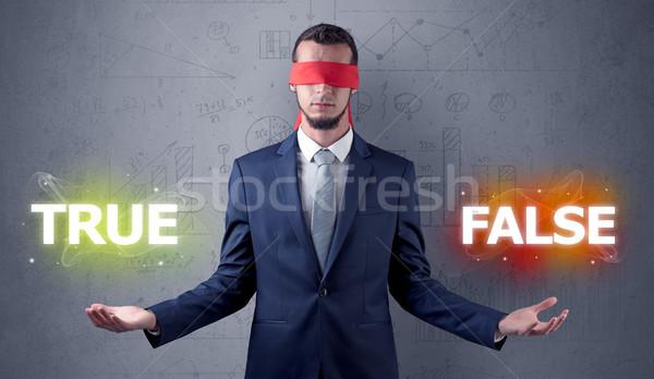 Man with ribbon on his eye making decision Stock photo © ra2studio