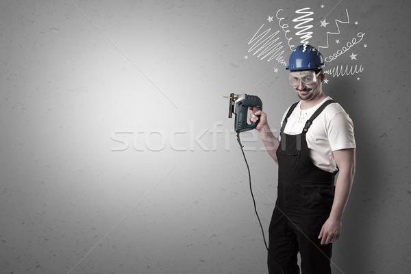 Factotum with tool.  Stock photo © ra2studio