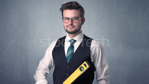 Stock photo: Businesman standing with tool on his hand