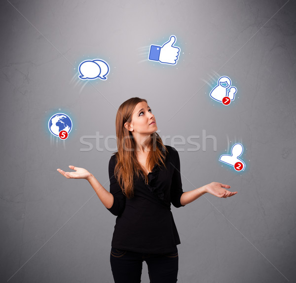 attractive young woman juggling with social network icons Stock photo © ra2studio