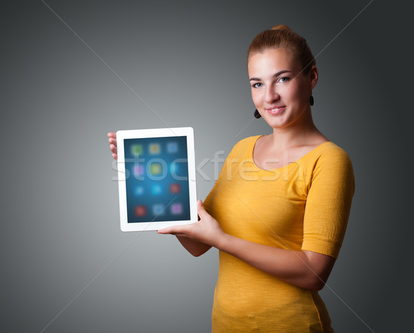 Stock photo: woman holding modern tablet with colorful icons