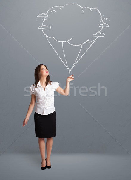 Pretty lady holding a cloud balloon drawing Stock photo © ra2studio