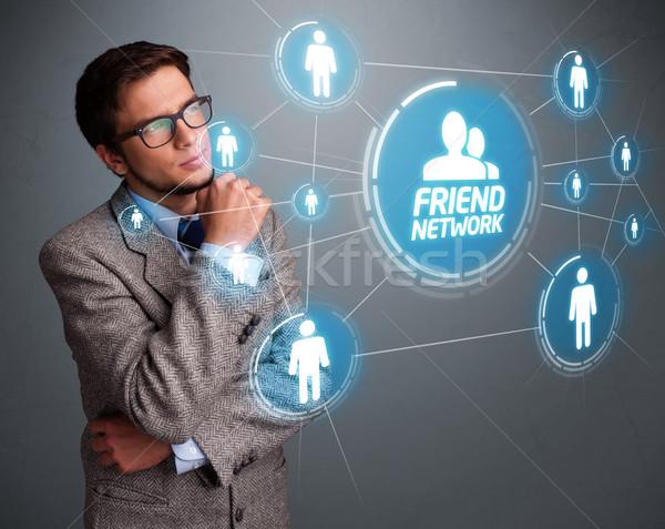 ストックフォト: ハンサムな男 · 見える · 現代 · 社会的ネットワーク · ハンサム · 若い男