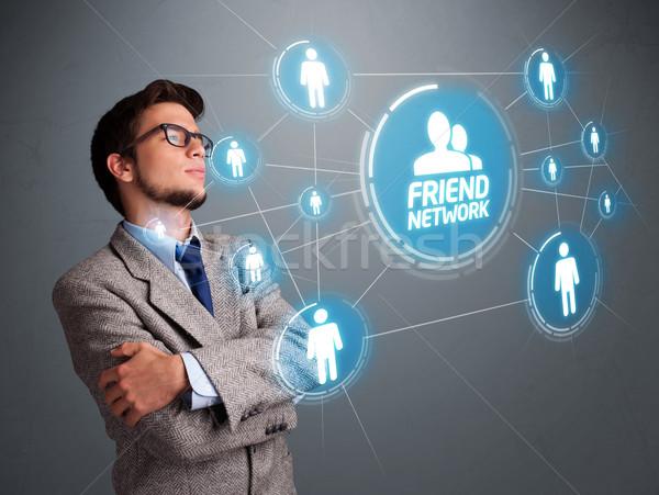 ハンサムな男 見える 現代 社会的ネットワーク ハンサム 若い男 ストックフォト © ra2studio