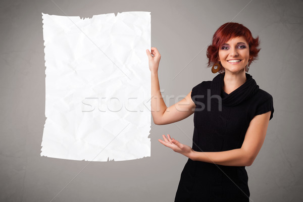 Young girl holding crumpled white paper copy space Stock photo © ra2studio