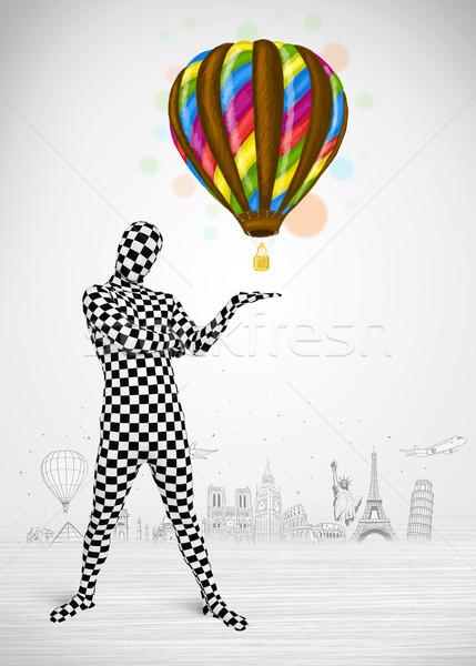 Férfi egészalakos öltöny tart léggömb vicces Stock fotó © ra2studio