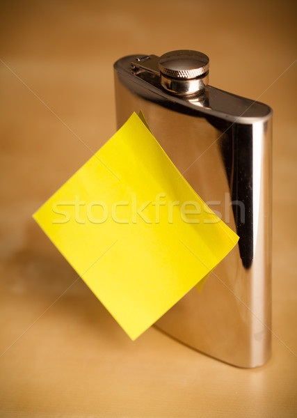 Empty post-it note sticked on hip flask Stock photo © ra2studio