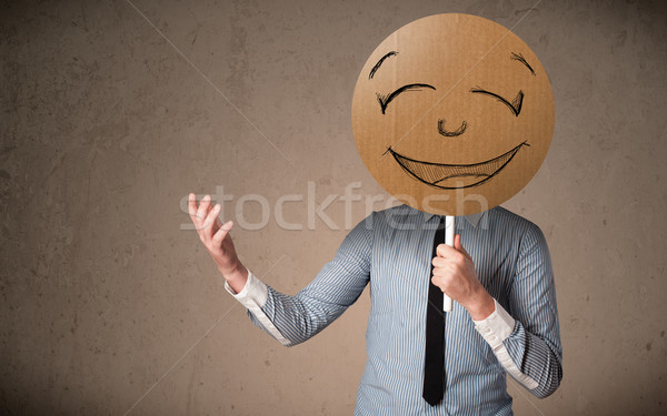 üzletember tart mosolygós arc tábla karton emotikon Stock fotó © ra2studio
