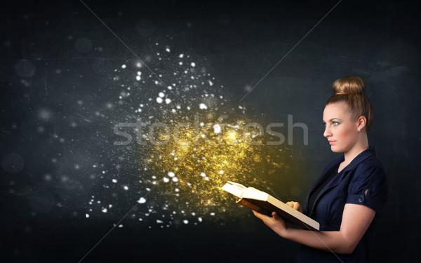 Fiatal hölgy olvas varázslatos könyv iskolatábla Stock fotó © ra2studio