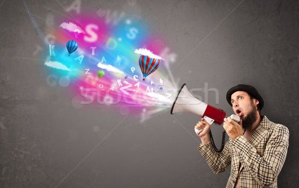 Stock photo: Man shouting into megaphone and abstract text and balloons come
