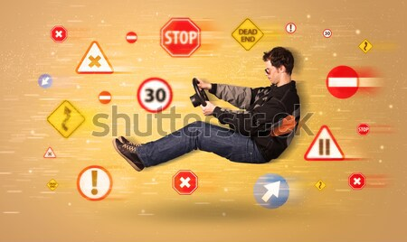 Genç sürücü yol işaretleri etrafında araba yol Stok fotoğraf © ra2studio