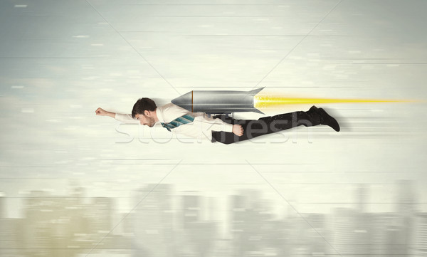 Superhero business man flying with jet pack rocket above the cit Stock photo © ra2studio
