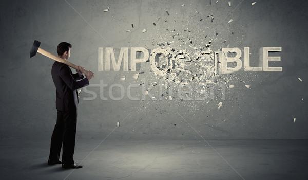 Homem de negócios impossível assinar martelo sujo parede Foto stock © ra2studio